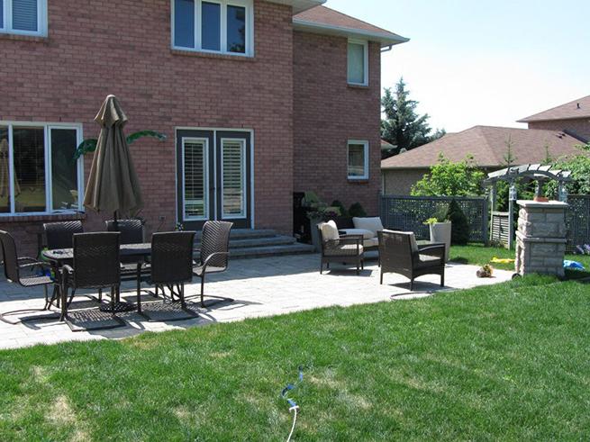 A backyard with patio furniture