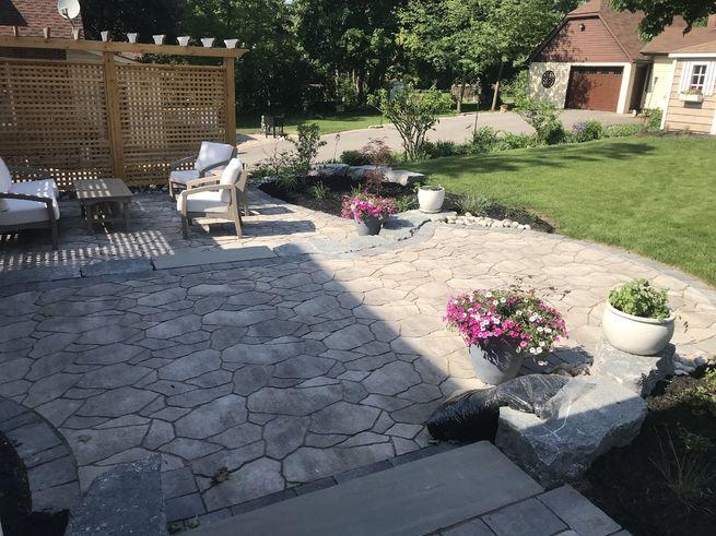 A backyard patio with a garden.