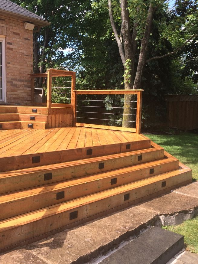 Wooden stairs leading up to a deck.