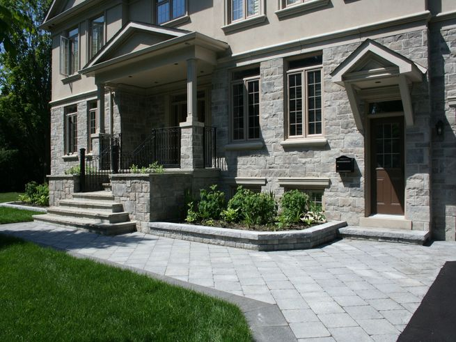 Patio walkway leading to stone stairs
