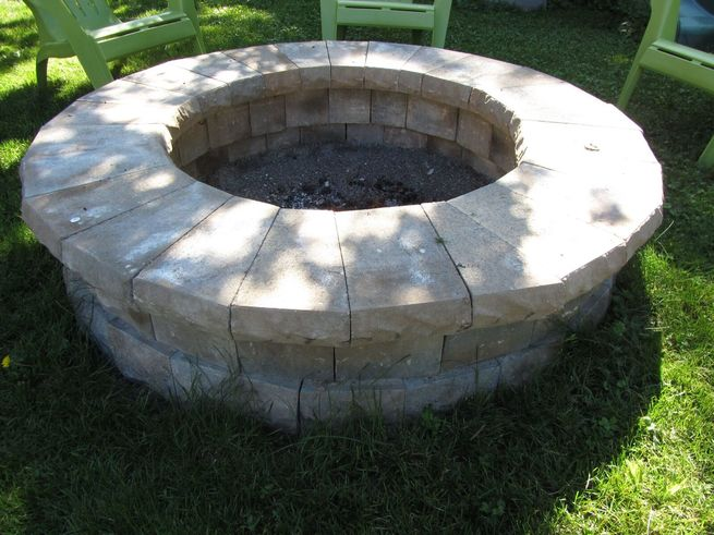 An outdoor stone fireplace.