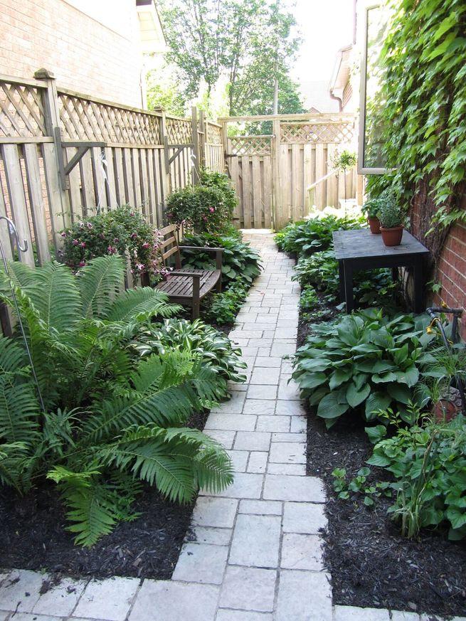 A patio walkway through the middle of a garden.