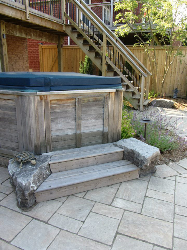 A hottub beside some stairs.