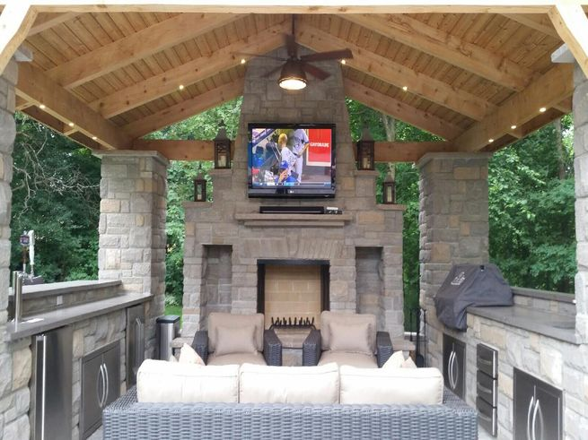 Interior of a gazebo with tv and furniture.