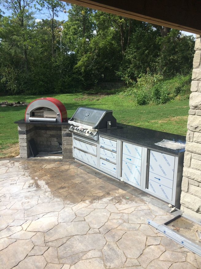 Outdoor kitchen featuring a patio floor with barbeque.