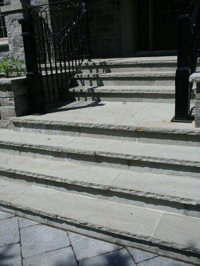 Stone stairs leading up to a door.